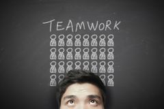 Businessman with teamwork concept on the blackboard Royalty Free Stock Image