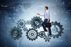 The businessman in teamwork concept with cog wheels Stock Images