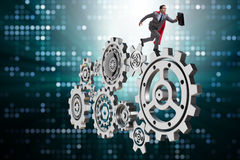 The businessman in teamwork concept with cogwheels Stock Photography