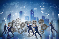 The businessman in teamwork concept with cogwheels Stock Image