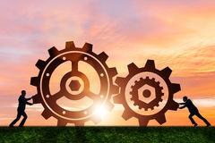 The businessman in teamwork concept with cogwheels Stock Images