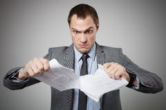 Businessman tearing contract Royalty Free Stock Images