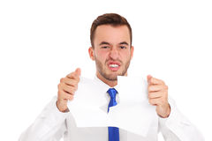 Businessman tearing documents Stock Image