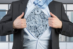 Businessman tearing his shirt with gray cogs Royalty Free Stock Photography