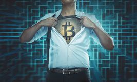 Businessman tearing his shirt open to reveal Bitcoin icon on che. St with digital background Royalty Free Stock Photo