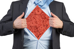 Businessman tearing his shirt with red gears Stock Images