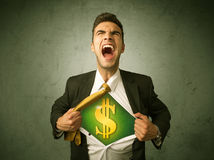Businessman tearing off his shirt with dollar sign on chest Royalty Free Stock Images