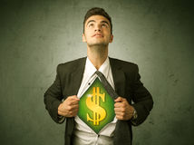Businessman tearing off his shirt with dollar sign on chest Royalty Free Stock Photography