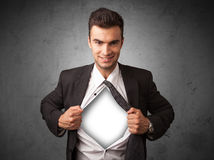 Businessman tearing off his shirt with white copyspace on chest Stock Images