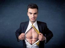 Businessman tearing off shirt and showing mucular body stock photo