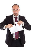 Businessman tearing paper Stock Photography