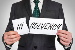 Businessman tearing paper with insolvency word Stock Photos