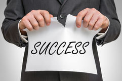 Businessman tearing paper with success word. Business idea concept Royalty Free Stock Photos