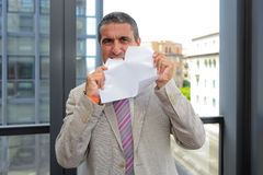 Businessman tearing a sheet Stock Photo