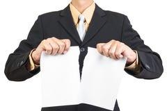 Businessman tearing sheet white paper Stock Image