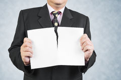 Businessman tearing sheet white paper Stock Images