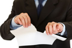 Businessman tearing sheet of white paper. Closeup Royalty Free Stock Image