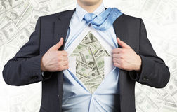 Businessman is tearing the shirt on the chest. Dollar notes under the shirt. The concept of the business soul. Royalty Free Stock Photo