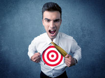 Businessman tearing shirt with target sign on his chest Royalty Free Stock Image
