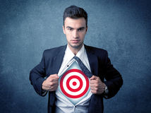 Businessman tearing shirt with target sign on his chest Stock Photo