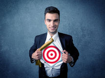 Businessman tearing shirt with target sign on his chest Stock Images
