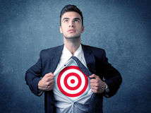 Businessman tearing shirt with target sign on his chest Royalty Free Stock Photography