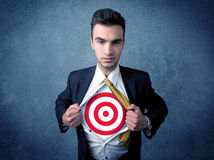 Businessman tearing shirt with target sign on his chest Royalty Free Stock Photo