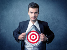 Businessman tearing shirt with target sign on his chest Royalty Free Stock Images