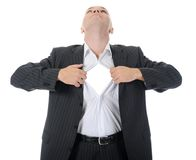 Businessman tears open his shirt Royalty Free Stock Photography