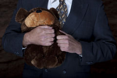 Businessman With a Teddy Bear Stock Image