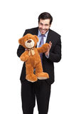 Businessman with a teddy bear Royalty Free Stock Image