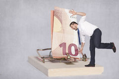 Businessman teetering on the edge of risk Stock Images