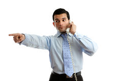Businessman on telephone pointing Royalty Free Stock Image