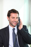 Businessman on the telephone smiling Royalty Free Stock Photos