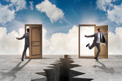 The businessman in teleportation concept with doors. Businessman in teleportation concept with doors Stock Photos