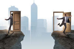 The businessman in teleportation concept with doors. Businessman in teleportation concept with doors stock photography