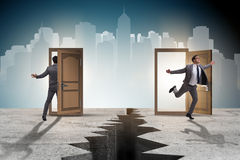 The businessman in teleportation concept with doors. Businessman in teleportation concept with doors Royalty Free Stock Image