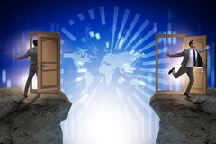 The businessman in teleportation concept with doors. Businessman in teleportation concept with doors stock photo