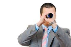 Businessman with telescope Stock Photos