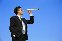 Businessman with telescope looking forward Royalty Free Stock Photo