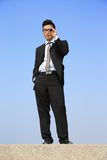 Businessman with telescope looking forward Royalty Free Stock Photography