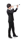 Businessman with telescope looking forward Stock Image