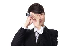 Businessman with telescope looking forward Stock Photo