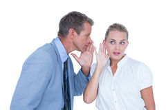 Businessman telling secret to a businesswoman Royalty Free Stock Photography