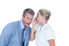 Businessman telling secret to a businesswoman Royalty Free Stock Images
