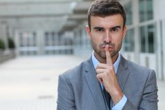 Businessman telling you to shut up stock image
