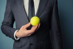 Businessman with tennis ball Stock Photography