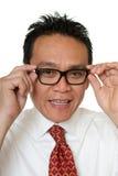 Businessman tests eyeglasses Royalty Free Stock Image