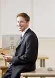 Businessman text messaging on cell phone. Businessman text messaging on a cell phone Stock Images