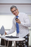 Businessman text messaging on a mobile phone Royalty Free Stock Photography